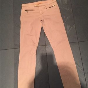 Tory Burch camel coloured low rise skinny jeans.